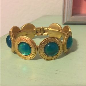 Coach bracelet in gold and blue stones